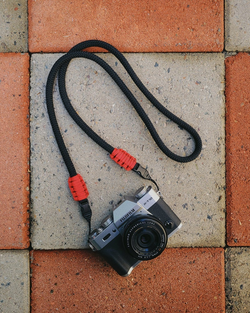 Image of Black rope shoulder strap w/ optech qd mini loop attachments