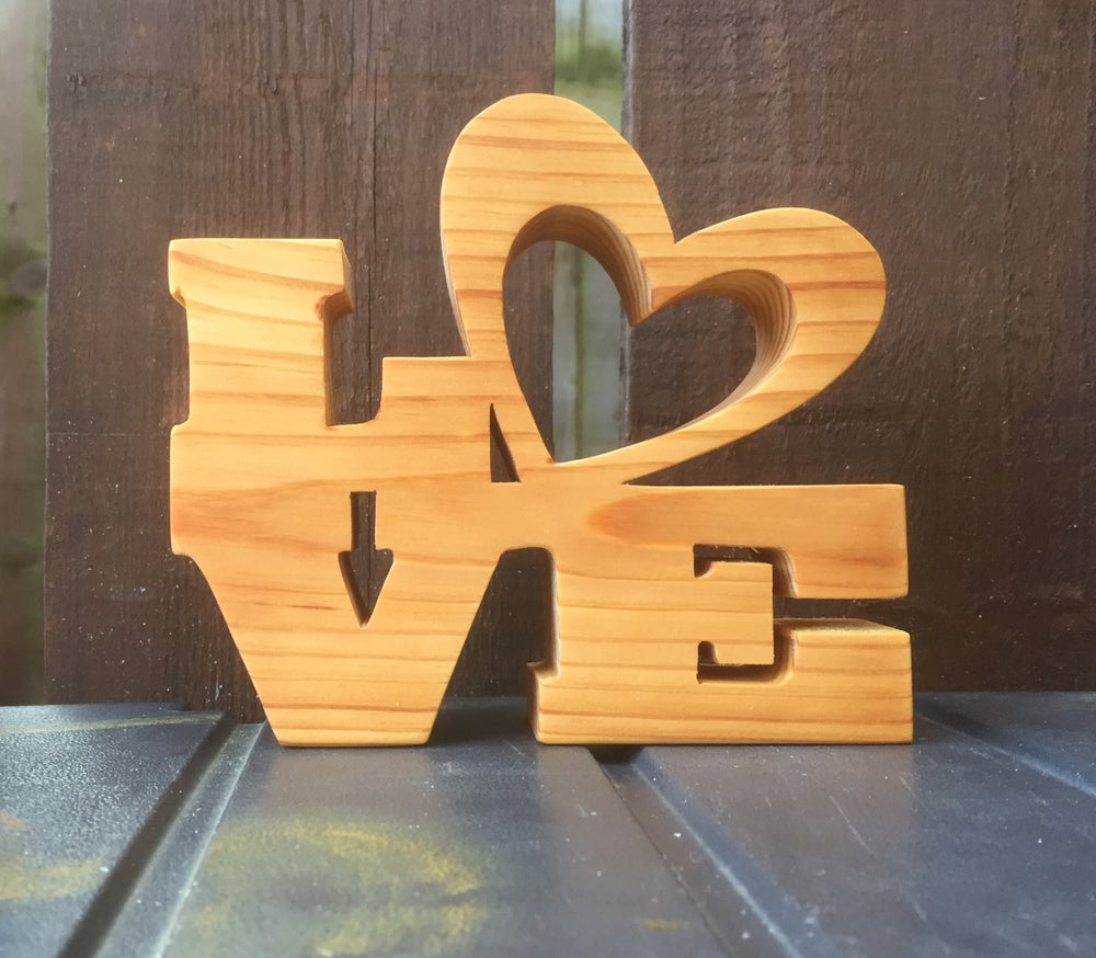 Image of Love in pine.