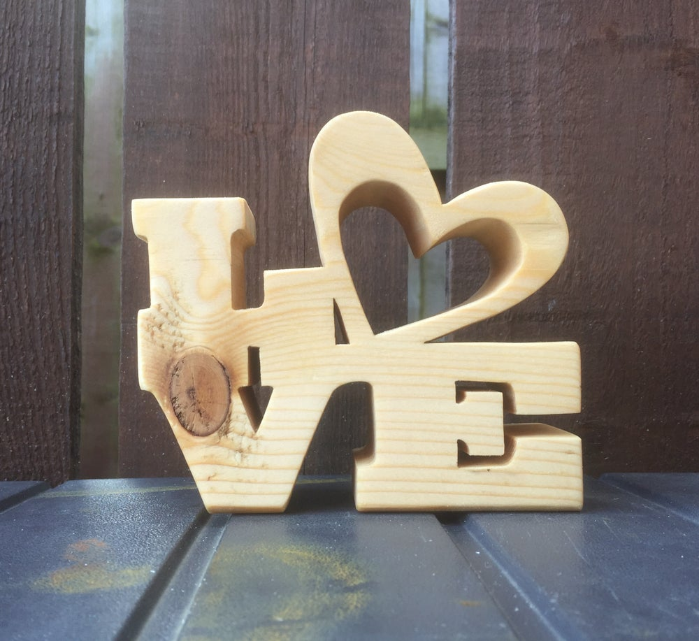 Image of Love.  In spruce.