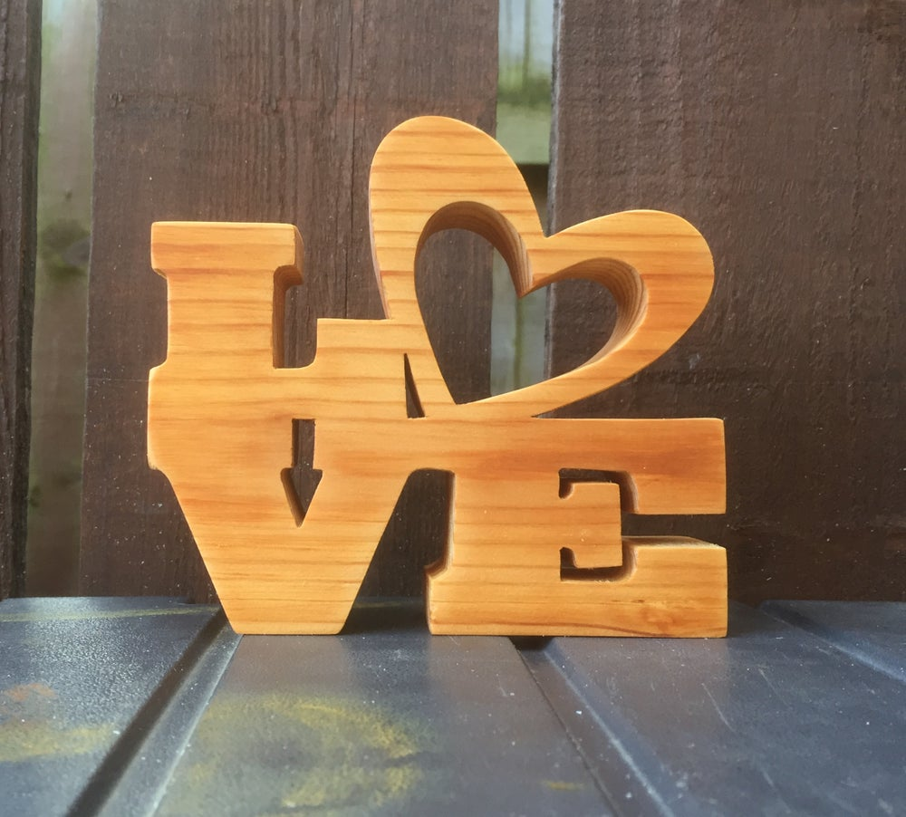 Image of Love in pine