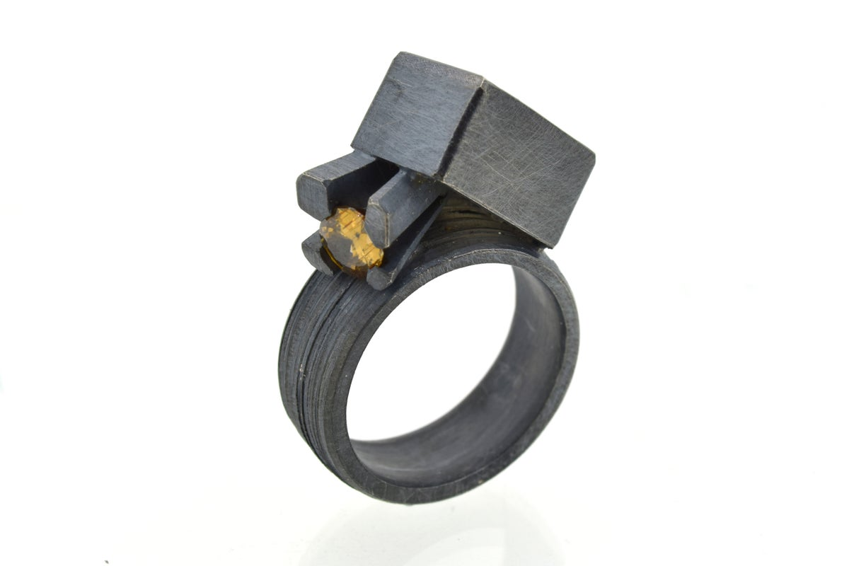Contemporary ring. Imperial topaz and zircon in oxidised silver by Chris Boland Jewellery