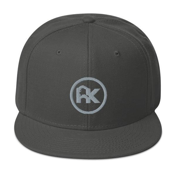 Image of CJAK logo - Gray on Charcoal Gray