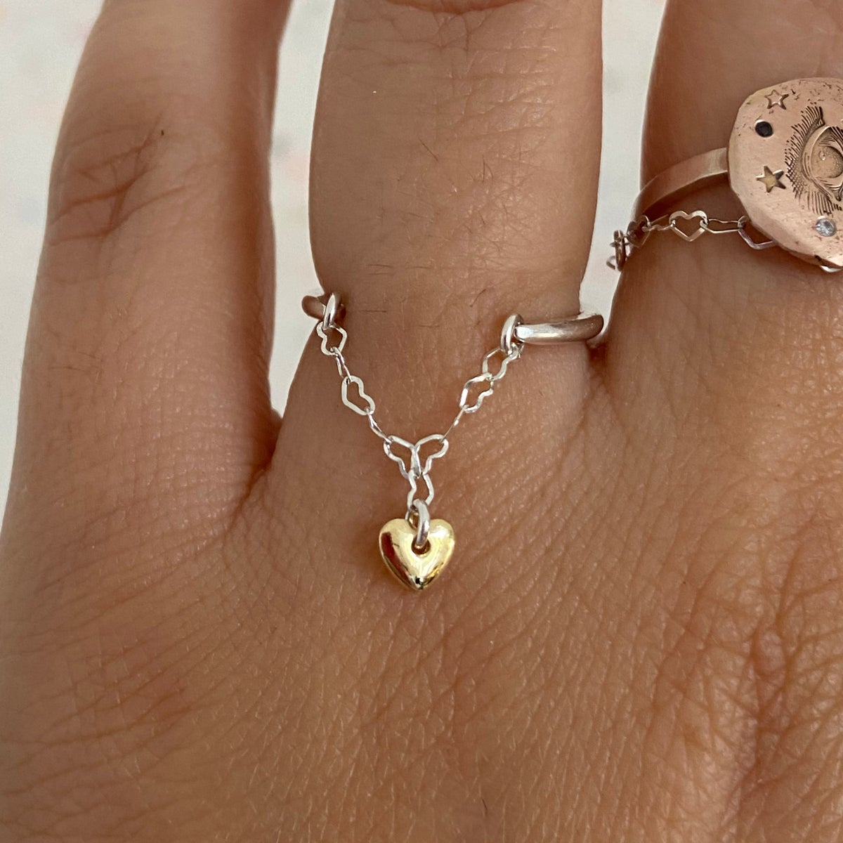 Image of double heart hanging ring