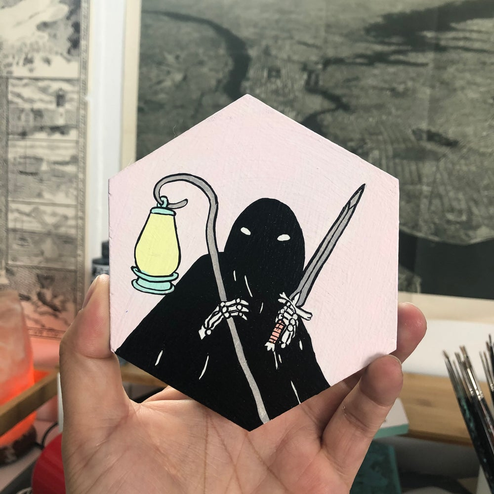 Image of Hooded Figure with Sword and Lantern