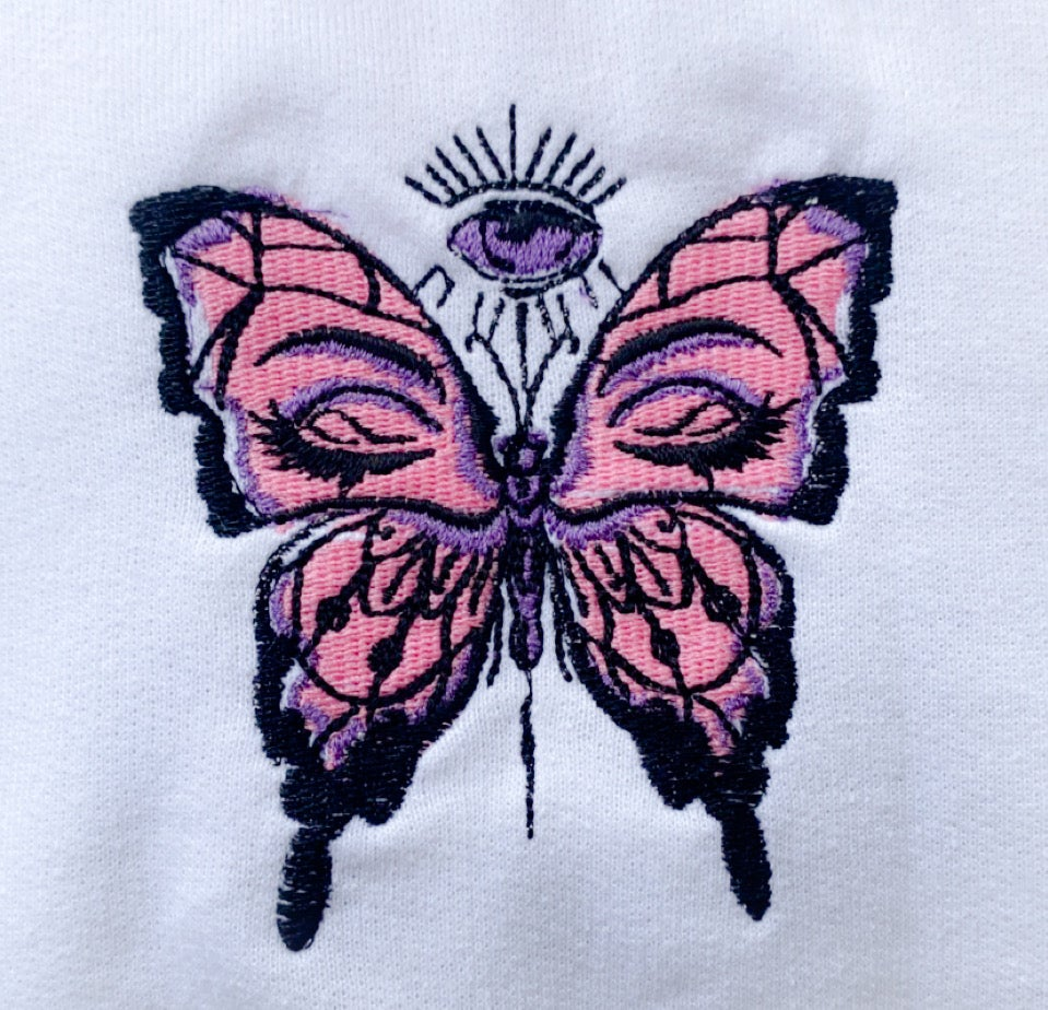 Image of white butterfly crewnecks