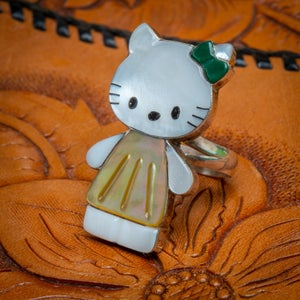 Image of Zuni Mother Of Pearl Chanel Inlay Sterling Silver Hello Kitty Ring Size 7 three quarters