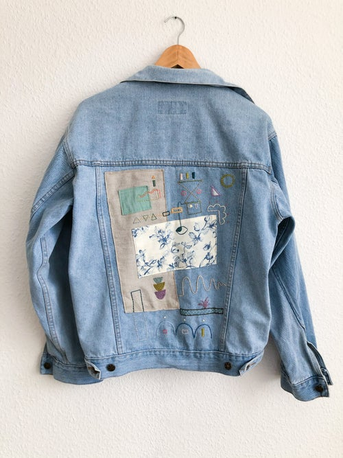 Image of Trying to focus - original hand embroidery +textile collage on a vintage denim jacket, one of a kind
