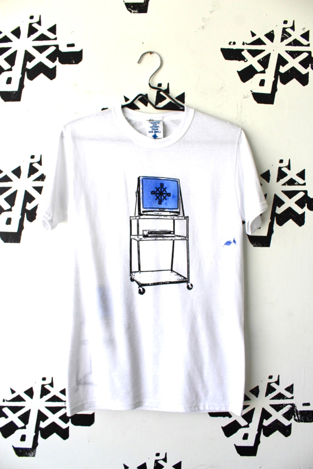 Image of watch and learn tee in white