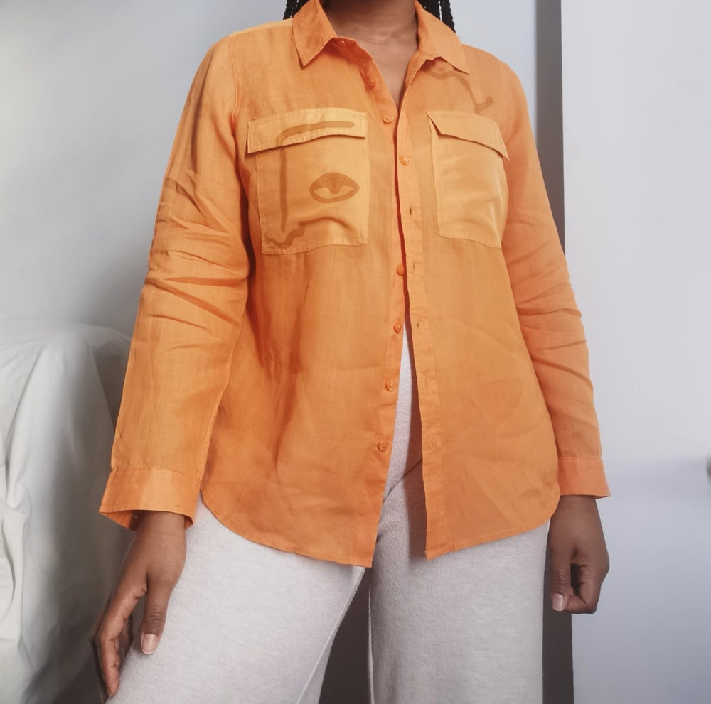 Image of tangerine shirt