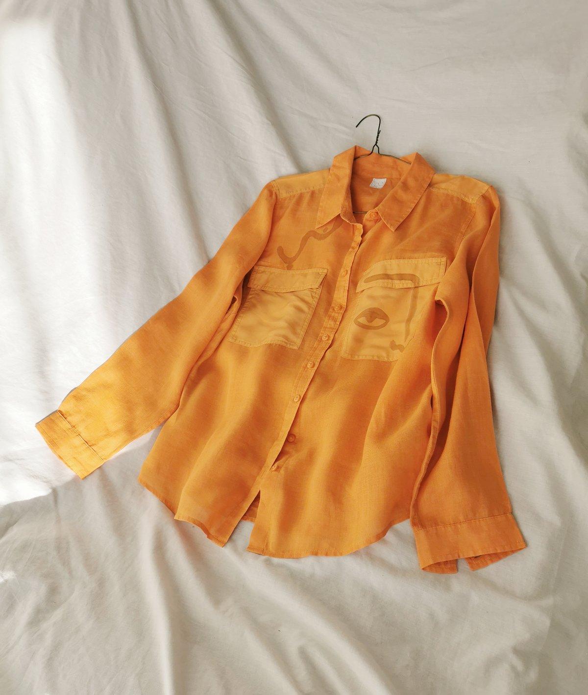Image of tangerine shirt