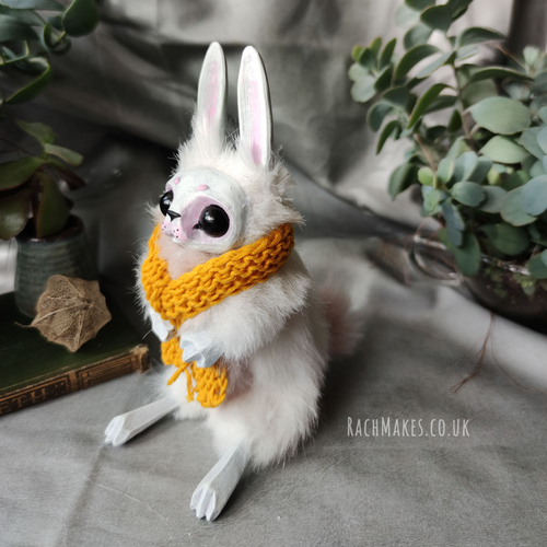 Image of White Bunn with Yellow Scarf