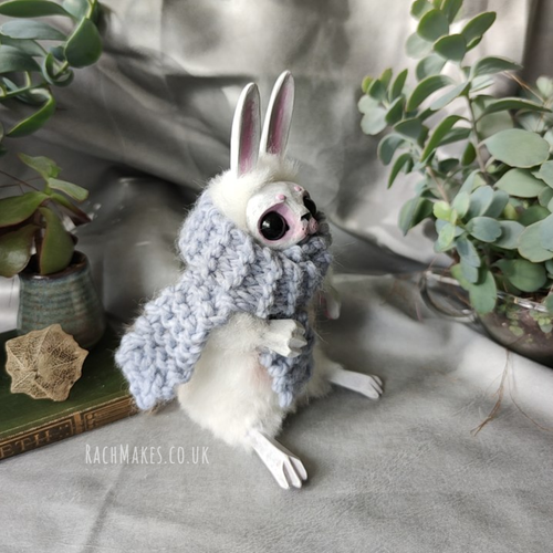 Image of White Bunn with Blue Scarf.