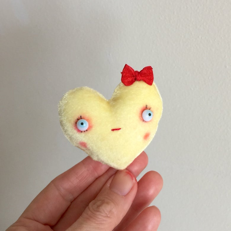 Image of Conversation Heart Pillow in Yellow with BE MINE
