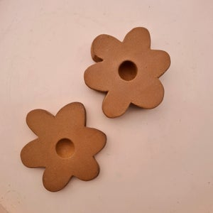 Image of TERRACOTTA DAISY CANDLE HOLDER