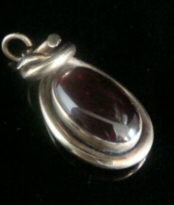 Image of VICTORIAN 15CT HIGH CARAT LARGE CABOCHON GARNET PENDANT WITH GLASS BACK
