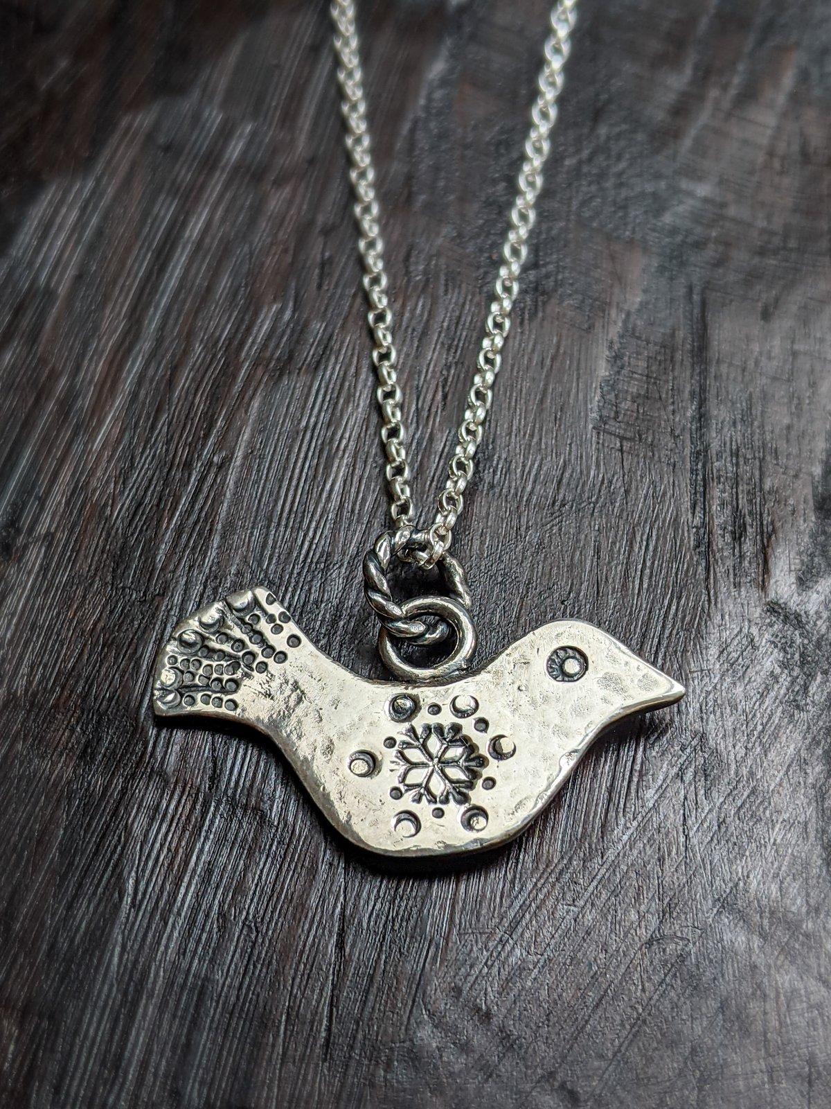 Winter Dove recycled silver bird pendant