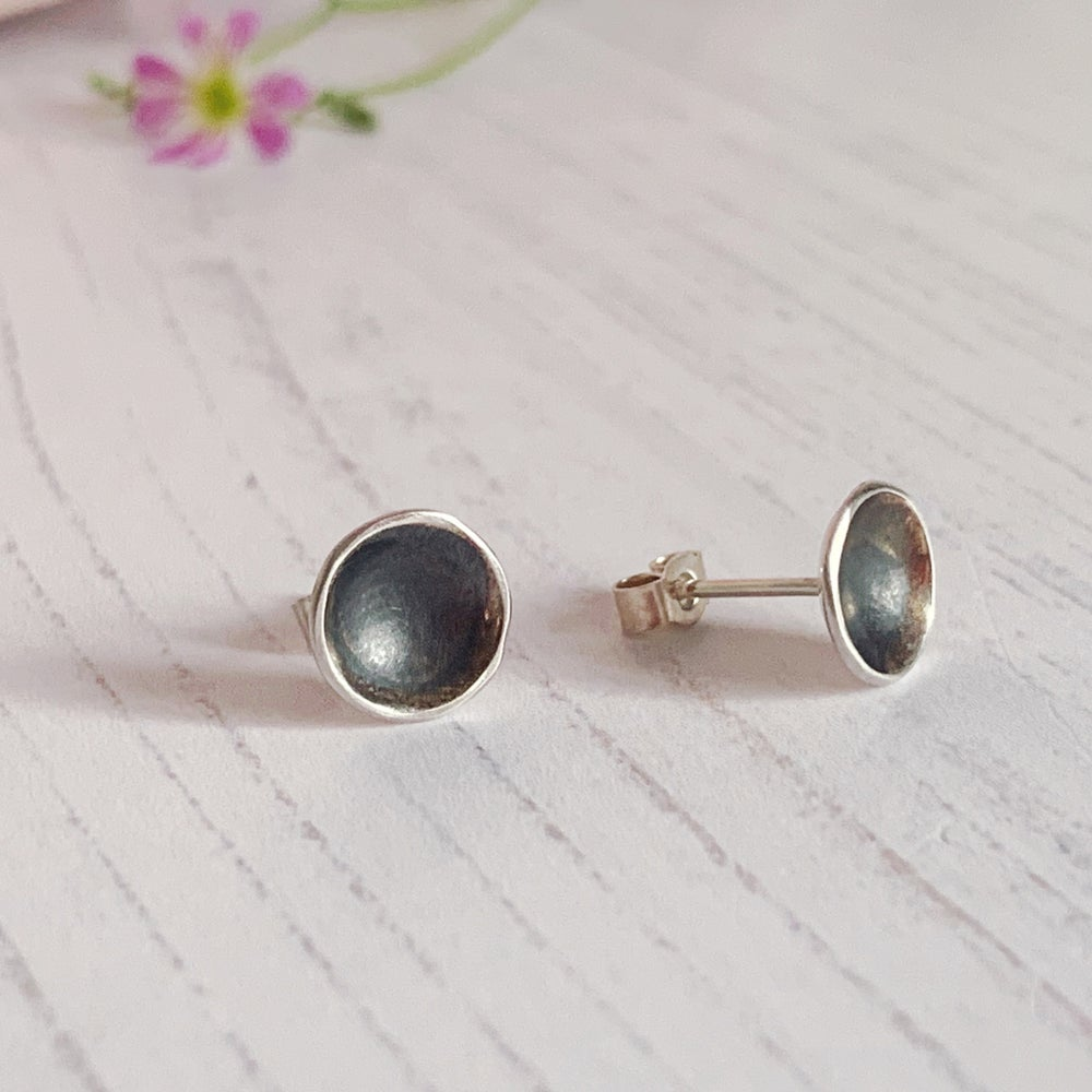 Image of Black domed stud earrings