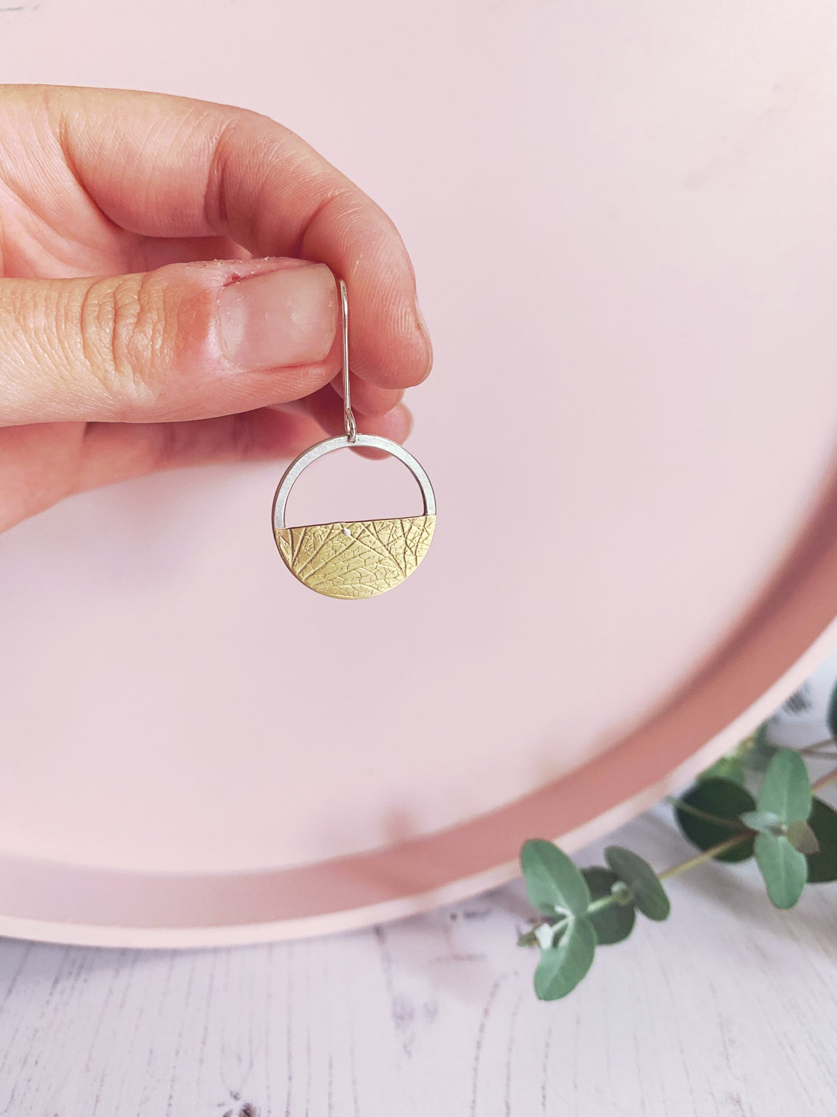 Image of Dangly circle earrings and brass semi circle with hydrangea petal imprint.