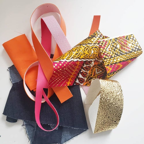 Image of Upcycled Orange and Denim Clutch
