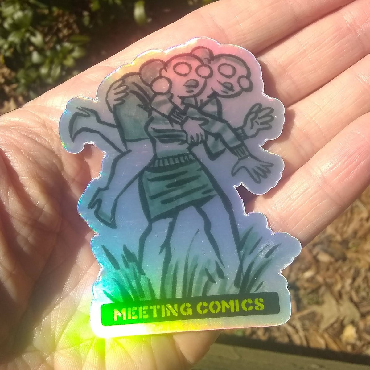Image of Meeting Comics Uncommon Val Holofoil Sticker