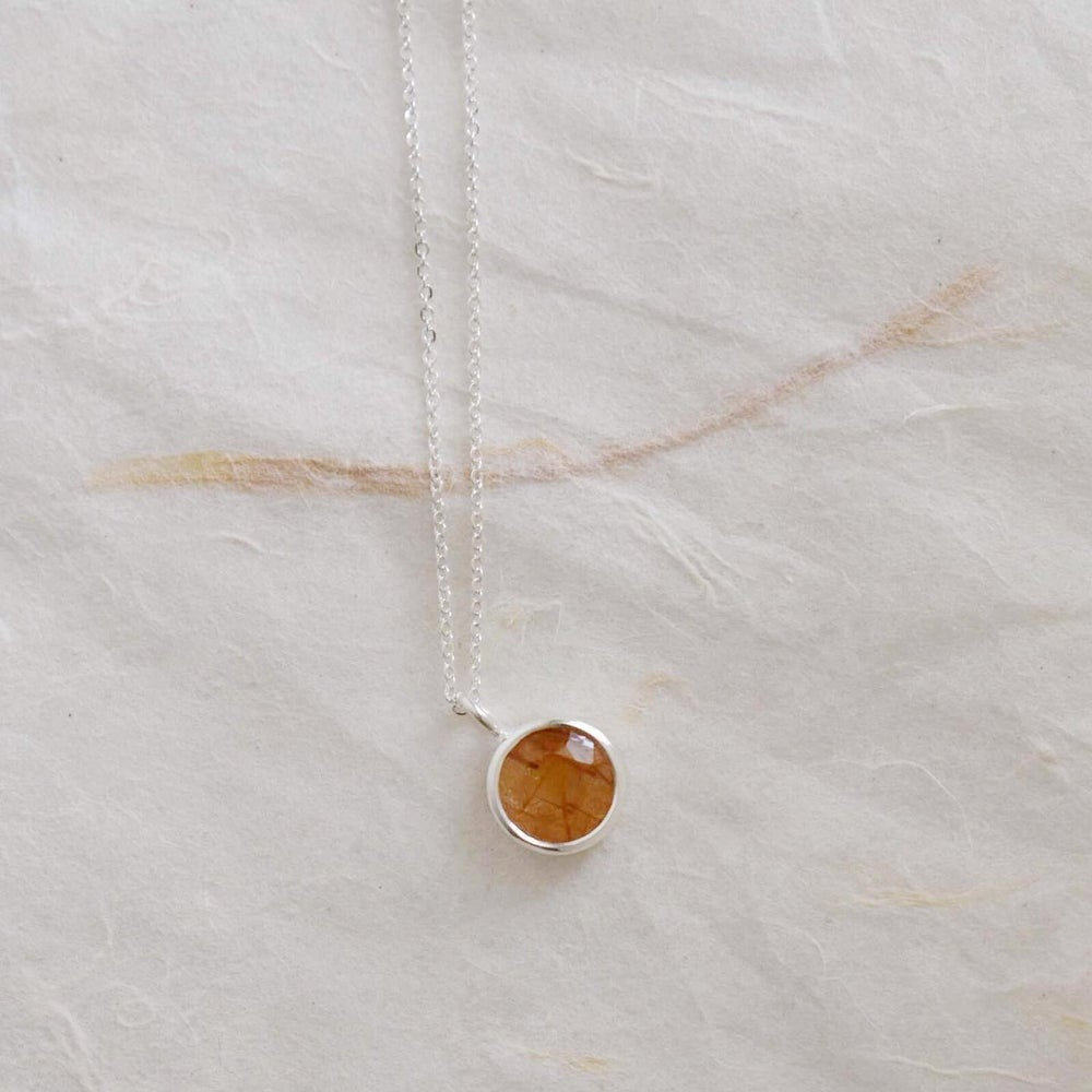 Image of Red Rutilated Quartz round cut silver necklace