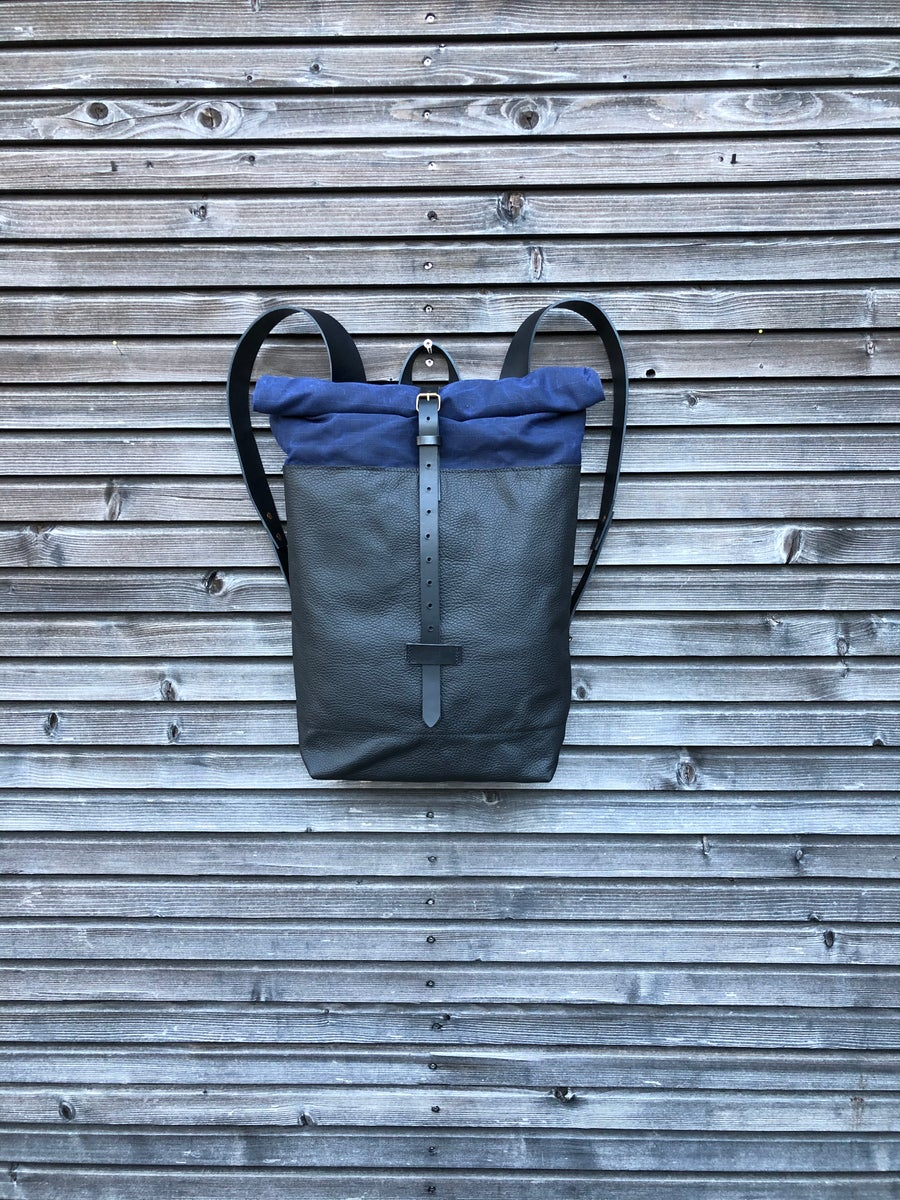 Image of Leather backpack with waxed canvas roll to close top