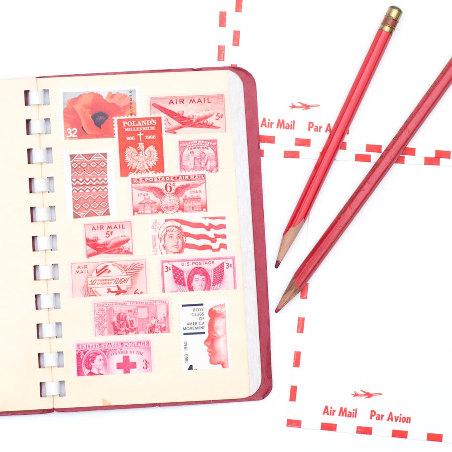 Image of Red Stock Book with Stamps and Ephemera
