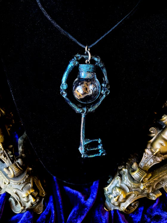 Image of Miniature Mummified Pigmy Seahorse Glass Globe Charm - Skeleton key Pendant.