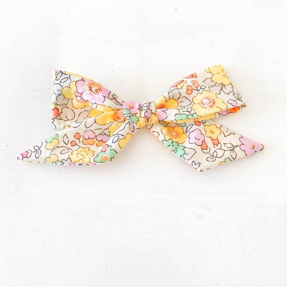 Image of Over Sized Hand Tied Hair Bow In Yellow Betsy Liberty Fabric