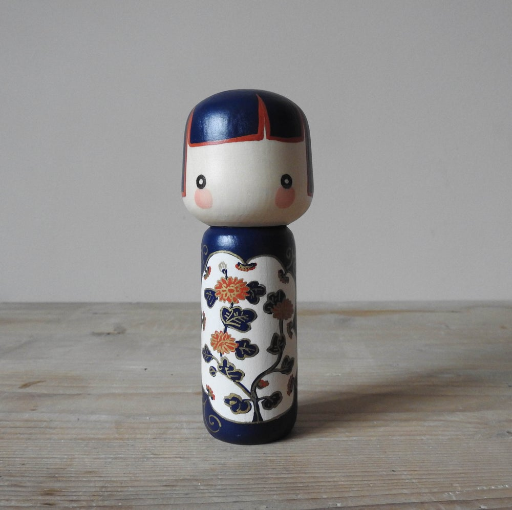 Image of ceramic girl - chrysanthemums