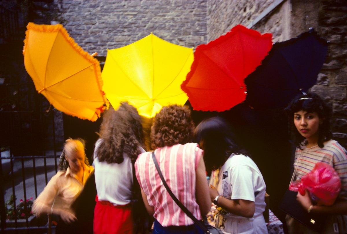 Street photography of buyers at umbrella sale
