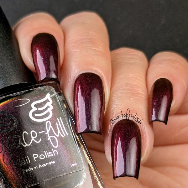 Image of Coincidental- multichrome the moves from black to red. The black has a purplish tinge