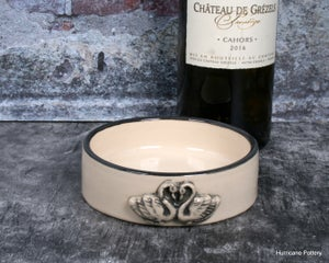 Image of Wine bottle coaster in creamy white porcelain with a pair of swans