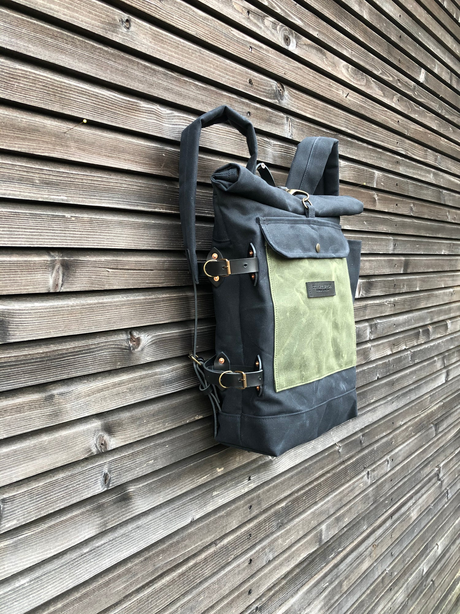 Image of Waxed canvas backpack with detachable leather side straps and padded laptop compartment / padded sho
