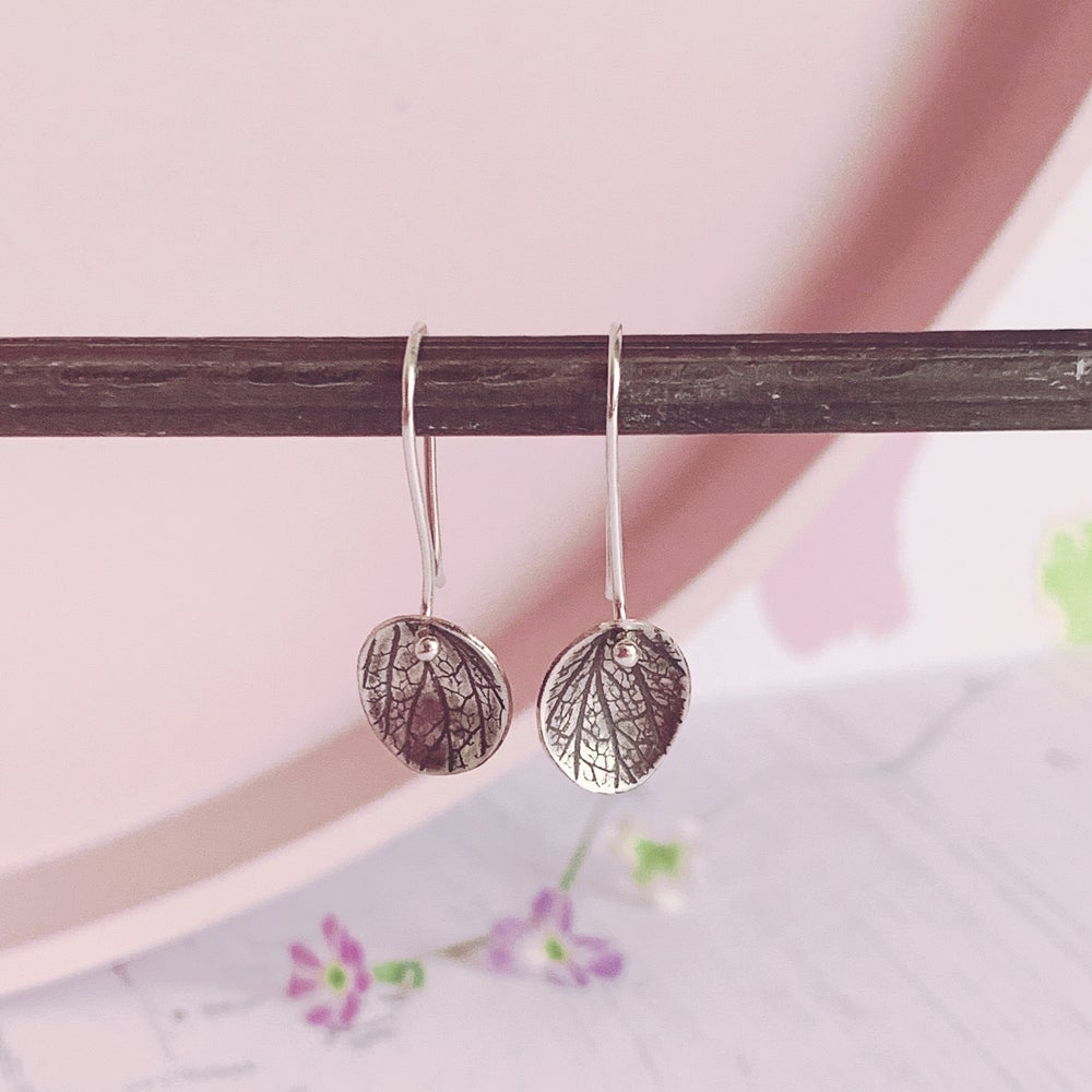 Image of Oval drop earrings with petal imprint