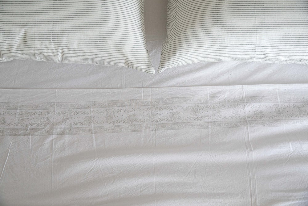Image of White Sheet with Cloud Border