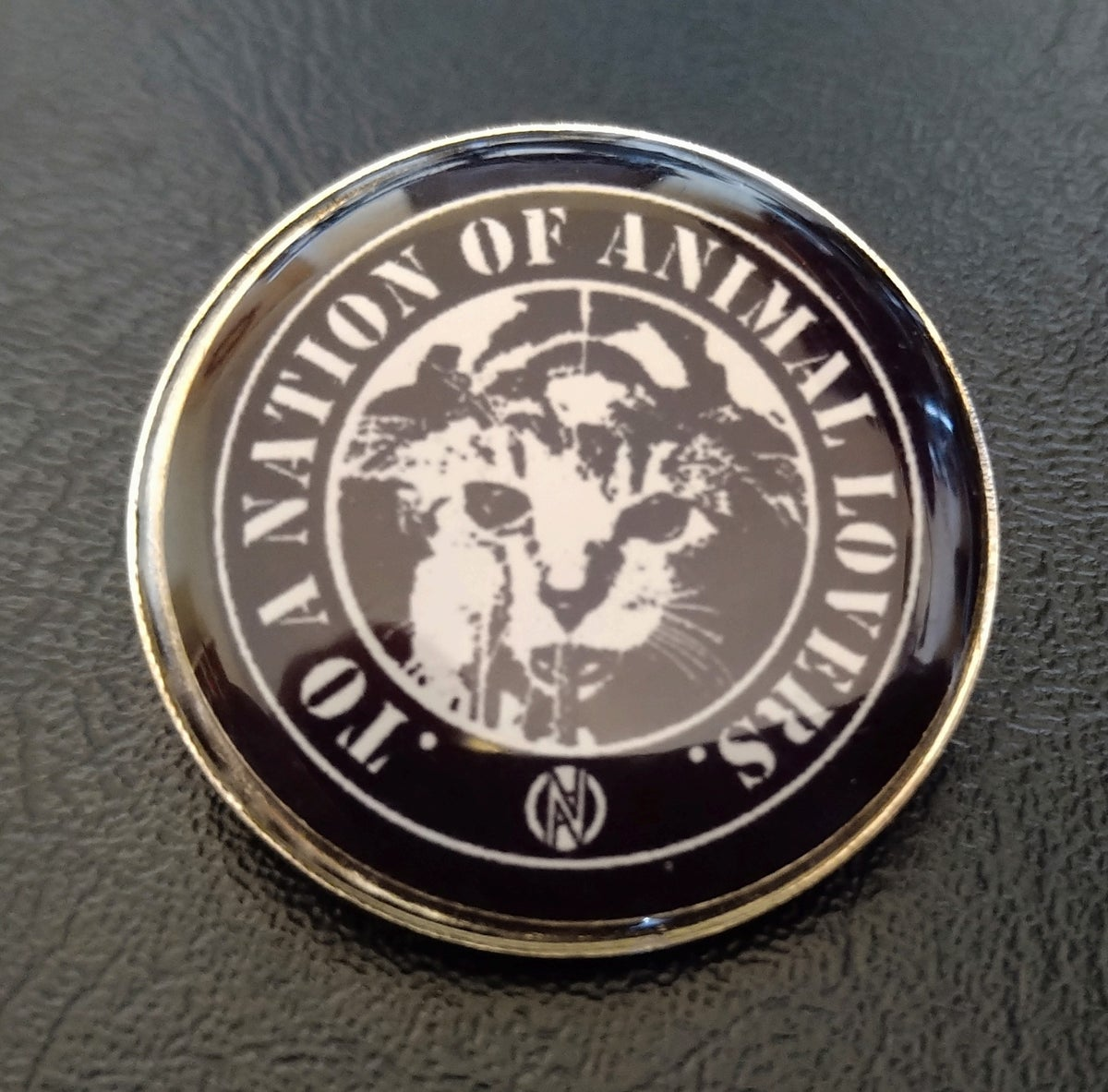 Image of To a Nation of Animal Lovers Metal Pin
