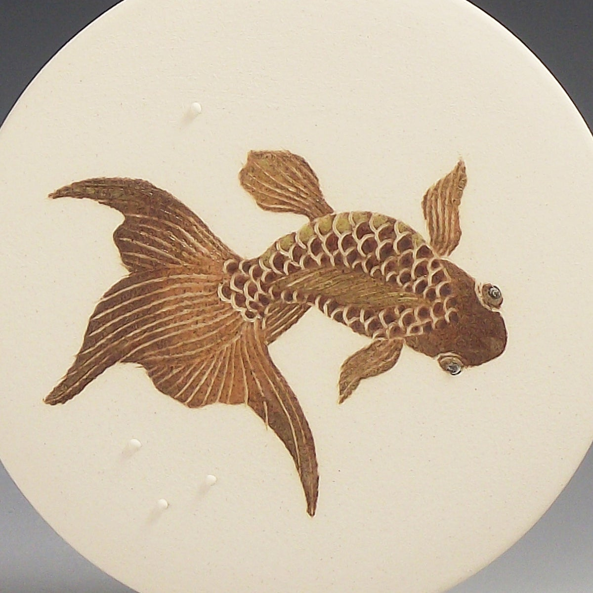 Short tailed fancy fish ceramic wall hanging