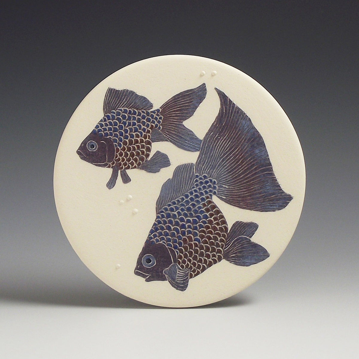 Two fancy fish ceramic wall hanging