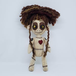 Gold eyed Voodoo doll