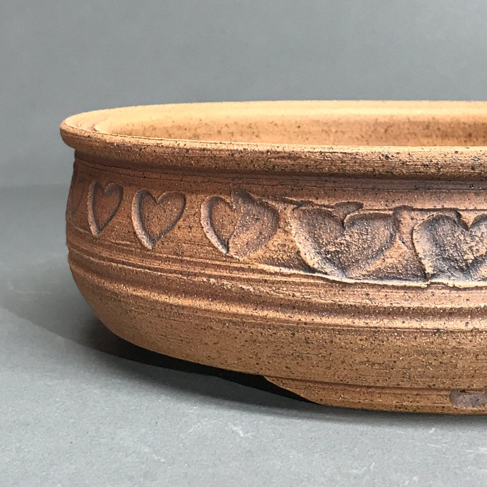 Image of 350 Unglazed Round with Band of Love