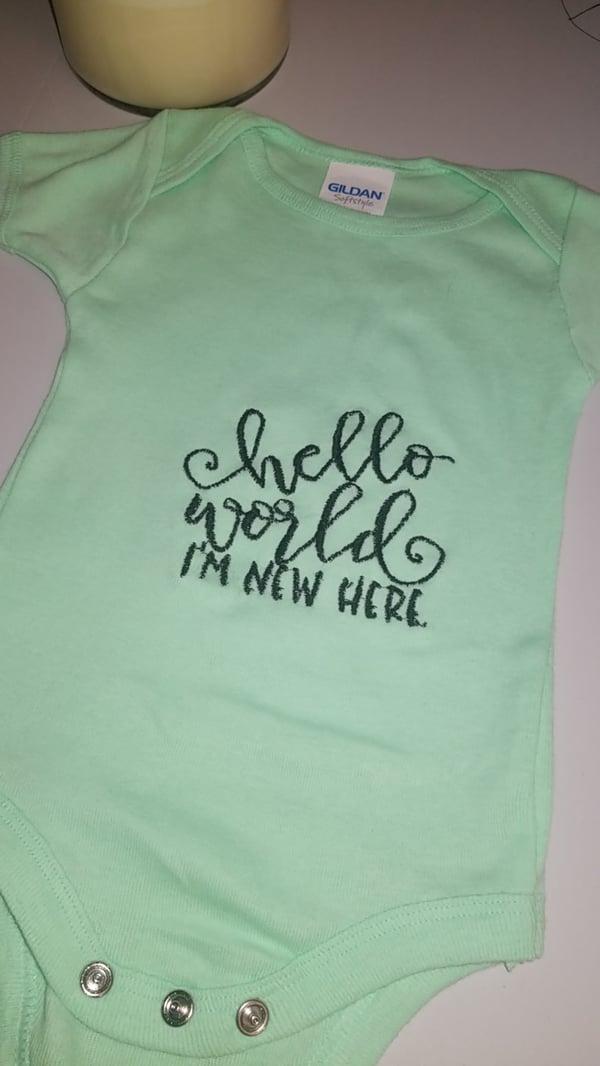 Image of Embroidered newborn onesies