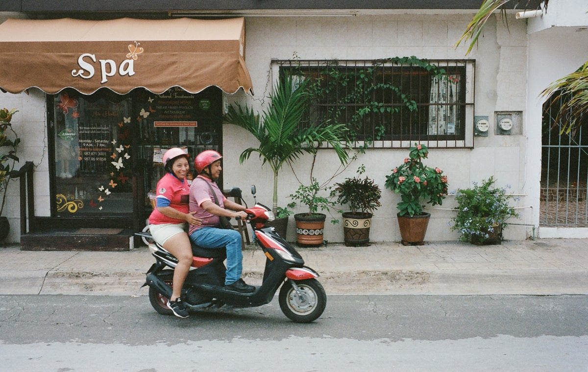Couple on a scooter in Mexico