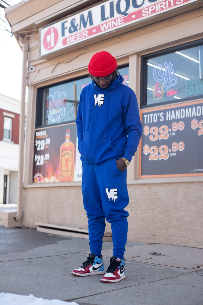 "Image of Nipsey Blue Unisex ""In The Middle"" Drip Patch Sweatsuit"