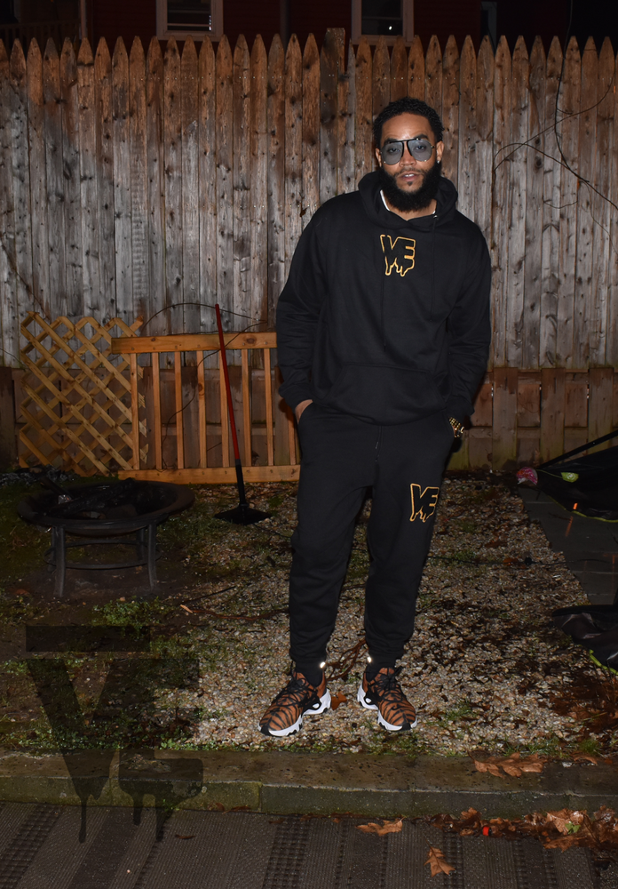 "Image of Black Unisex ""In The Middle"" Drip Patch Sweatsuit"