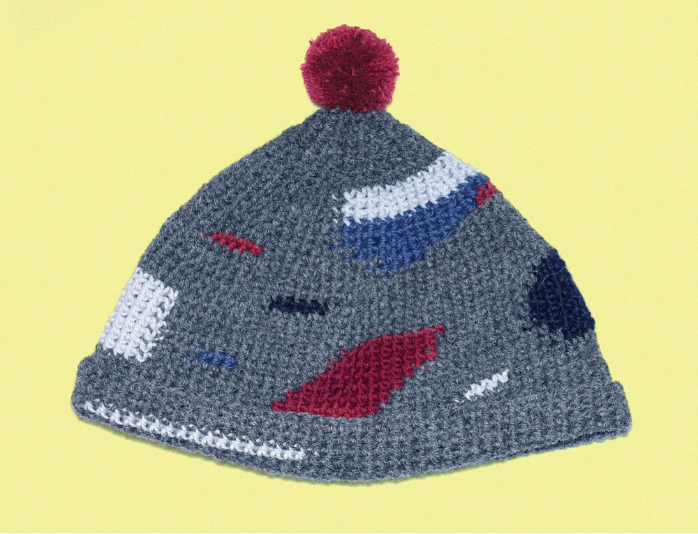 Image of GREY CAP WITH RED POMPOM