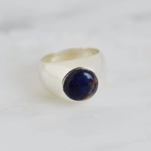 Image of Sodalite cabochon cut solid frame silver signet ring
