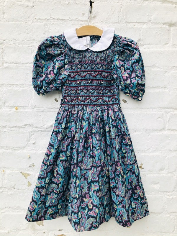 Image of Dramatic floral dress with smocking and contrast Peter Pan collar. Age 4-5yrs.