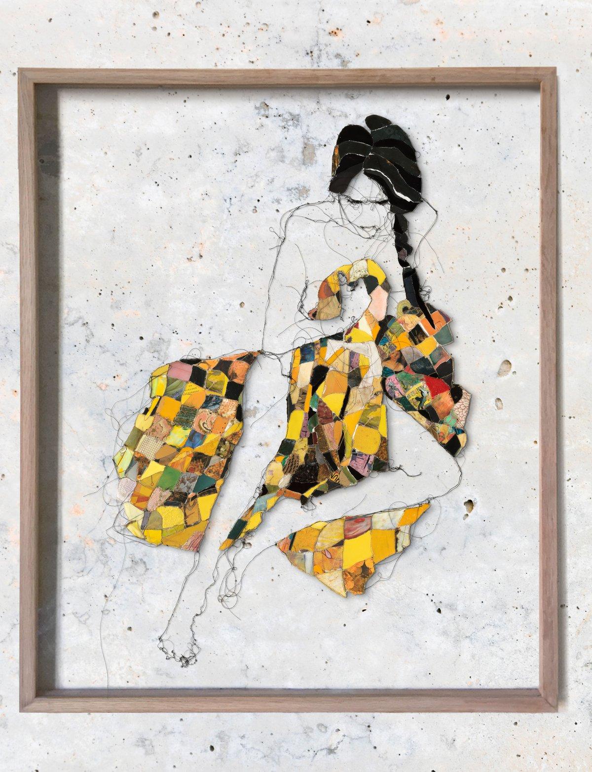 Image of Melancholic woman in yellow blanket