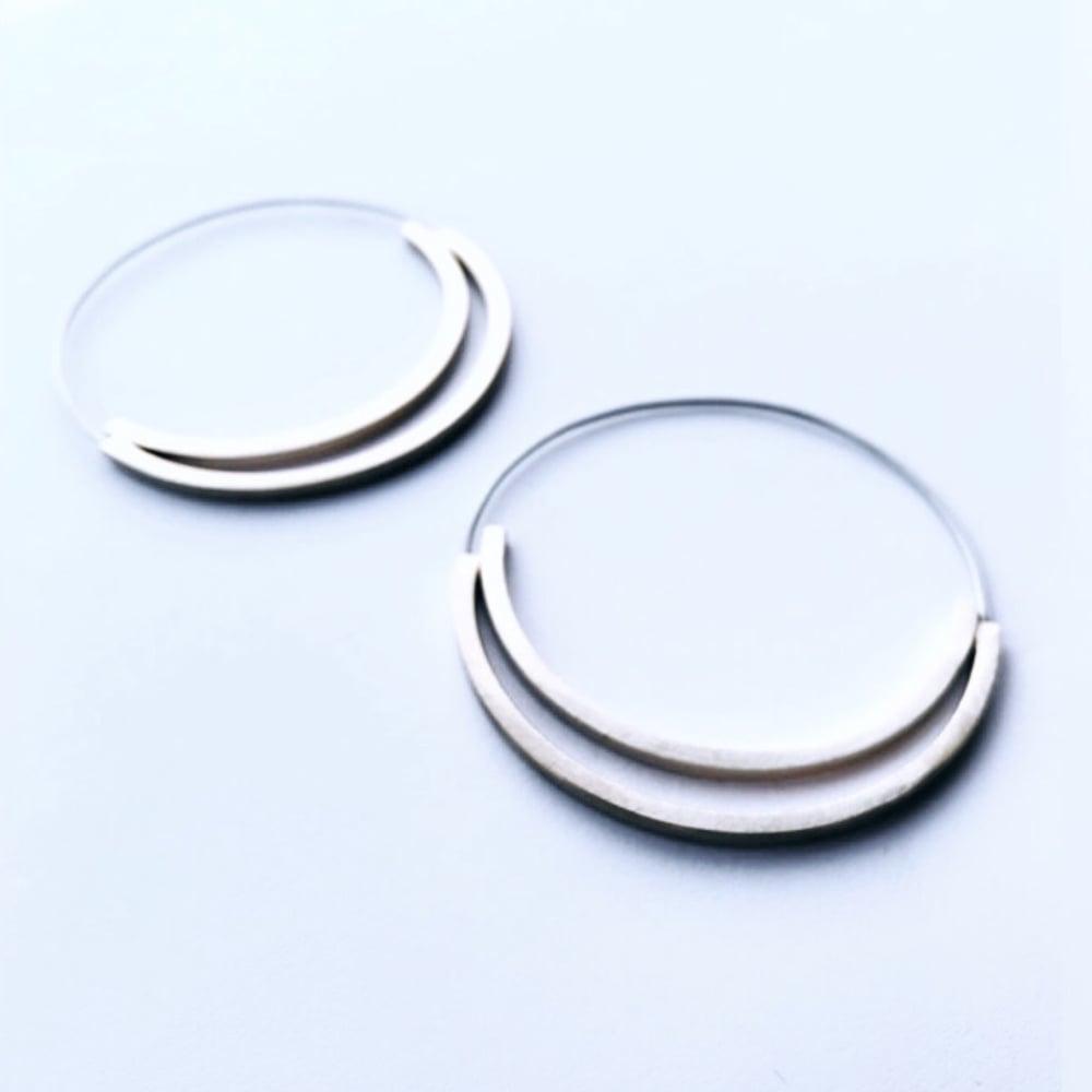 Image of Arracades Reflex doble. Pendientes Reflejo doble